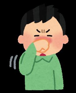 鼻をこする男性