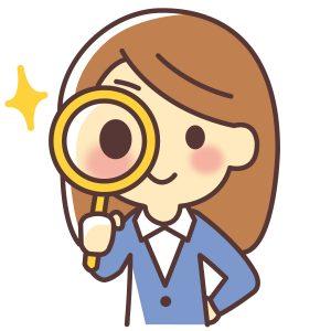 虫眼鏡で調べる女性